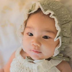 女の子のお食い初めの服装や衣装。ドレスや普段着のロンパースなどのベビー服
